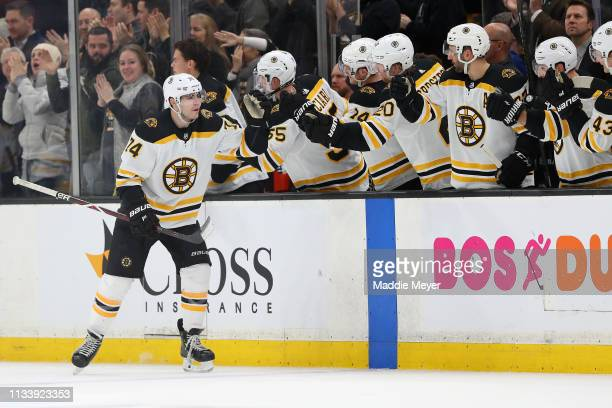 Jake DeBrusk of the Boston Bruins celebrates with teammates after scoring a goal against the Carolina Hurricanes during the second period at TD...