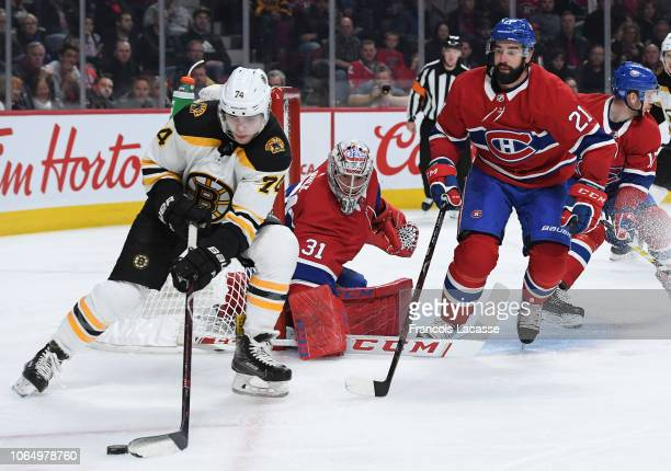 Jake DeBrusk of the Boston Bruins controls the puck against the Montreal Canadiens in the NHL game at the Bell Centre on November 24 2018 in Montreal...