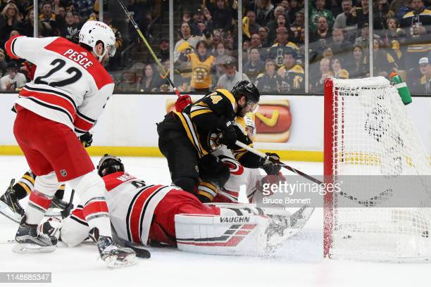Jake DeBrusk of the Boston Bruins scores a first period goal against the Carolina Hurricanes in Game Two of the Eastern Conference Final during the...
