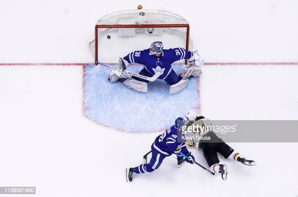Jake DeBrusk of the Boston Bruins scores a goal against Frederik Andersen of the Toronto Maple Leafs during the second period during Game Six of the...
