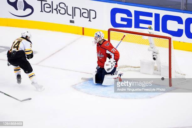 Jake DeBrusk of the Boston Bruins scores a goal on Braden Holtby of the Washington Capitals during the third period in an Eastern Conference Round...