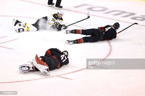 Jake DeBrusk of the Boston Bruins scores a goal past James Reimer of the Carolina Hurricanes during the third period in Game Four of the Eastern...