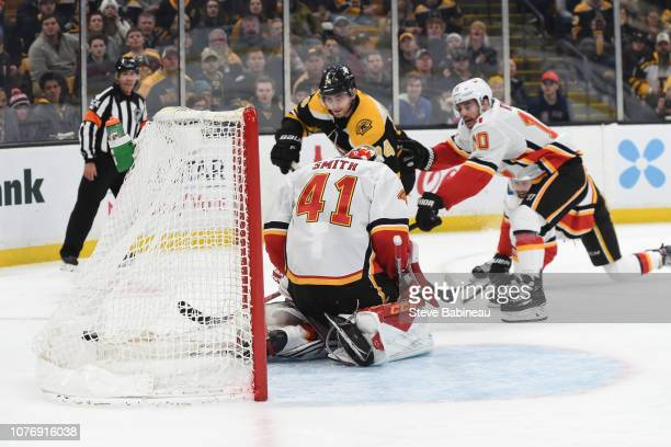 Jake DeBrusk of the Boston Bruins scores against Mike Smith of the Calgary Flames at the TD Garden on January 3 2019 in Boston Massachusetts