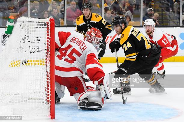 Jake DeBrusk of the Boston Bruins scores against the Detroit Red Wings at the TD Garden on October 13 2018 in Boston Massachusetts