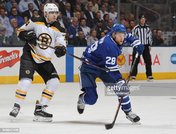 Jake DeBrusk of the Boston Bruins skates against Connor Brown of the Toronto Maple Leafs in Game Three of the Eastern Conference First Round during...
