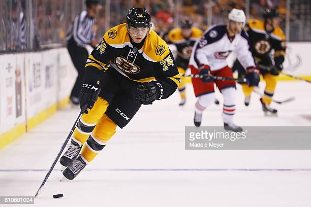 Jake DeBrusk of the Boston Bruins skates against the Columbus Blue Jackets during overtime of the preseason game at TD Garden on September 26 2016 in...