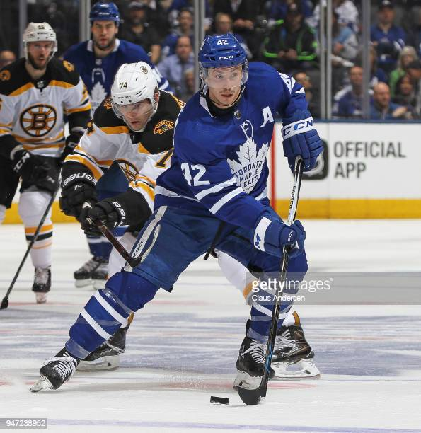 Jake DeBrusk of the Boston Bruins skates to check Tyler Bozak of the Toronto Maple Leafs in Game Three of the Eastern Conference First Round during...