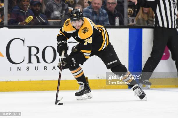 Jake DeBrusk of the Boston Bruins skates with the puck against the Calgary Flames at the TD Garden on January 3 2019 in Boston Massachusetts
