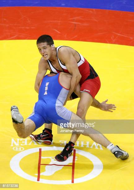 Jake Deitchler throws Faruk Sahin in the Greco- Roman 66kg division championship match during the USA Olympic trials for wrestling and judo on June...