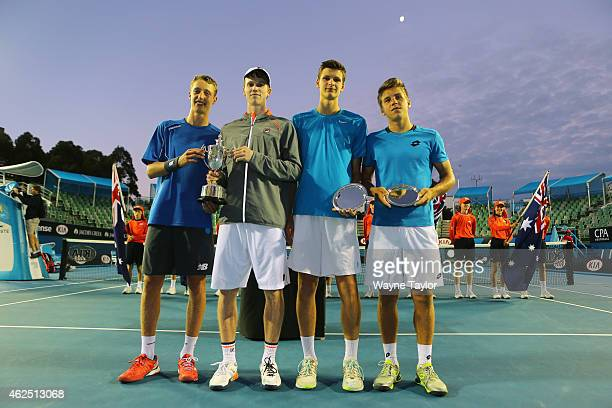 Jake Delaney of Australia and Marc Polmans of Australia pose with the winners trophy after winning their Junior Boys' Doubles Final against Hubert...