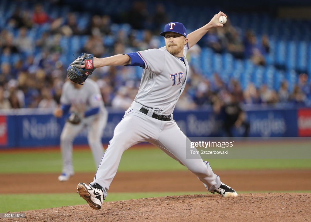 Jake Diekman #41 of the Texas Rangers delivers a pitch in the seventh inning during MLB game action against the Toronto Blue Jays at Rogers Centre on April 29, 2018 in Toronto, Canada.