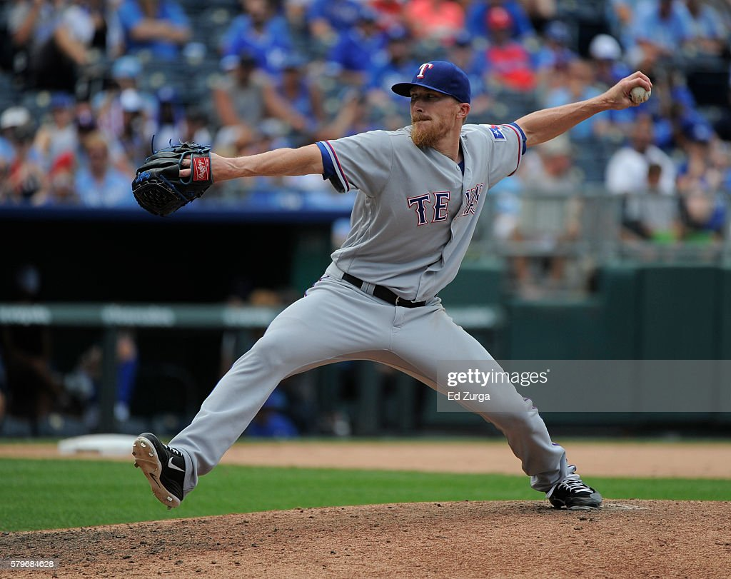 Jake Diekman #41 of the Texas Rangers pitches in the eighth inning against the Kansas City Royals at Kauffman Stadium on July 24, 2016 in Kansas City, Missouri.