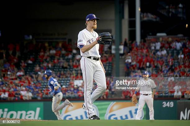 Jake Diekman of the Texas Rangers reacts as Jose Bautista of the Toronto Blue Jays runs the bases after hitting a three run home run to left field...
