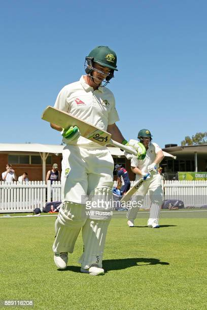 Jake Doran and Travis Dean of the Cricket Australia XI walk out to bat during the Two Day tour match between the Cricket Australia CA XI and England...