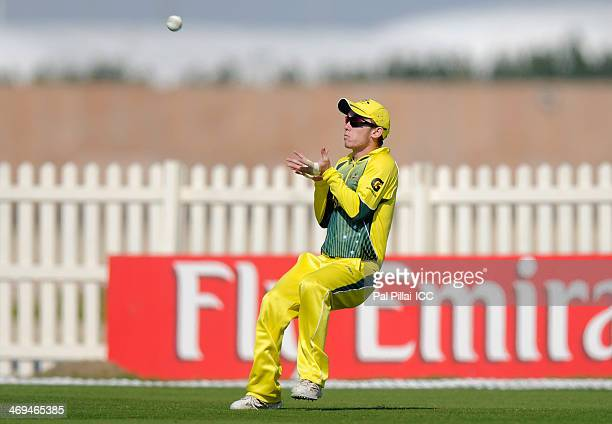 Jake Doran of Australia gets ready to take a catch to get the wicket of JP Kotze of Namibia during the ICC U19 Cricket World Cup 2014 match between...