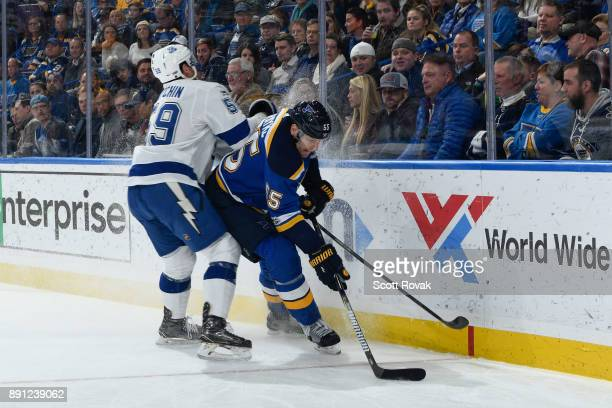 Jake Dotchin of the Tampa Bay Lightning defends against Colton Parayko of the St Louis Blues at Scottrade Center on December 12 2017 in St Louis...