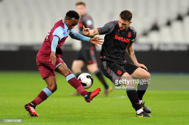 Jake Dunwoody of Stoke City battles for possession with Amadou Diallo of West Ham United during the Premier League 2 match between West Ham United...