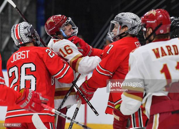 Jake Durflinger of the Denver Pioneers and Wyatt Ege of the Ohio State Buckeyes fight in the first period during an NCAA Division I Men's Ice Hockey...