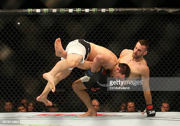 Jake Ellenberger punches Tarec Saffiedine in their welterweight bout during the UFC Fight Night event at the Prudential Center on January 30, 2016 in...