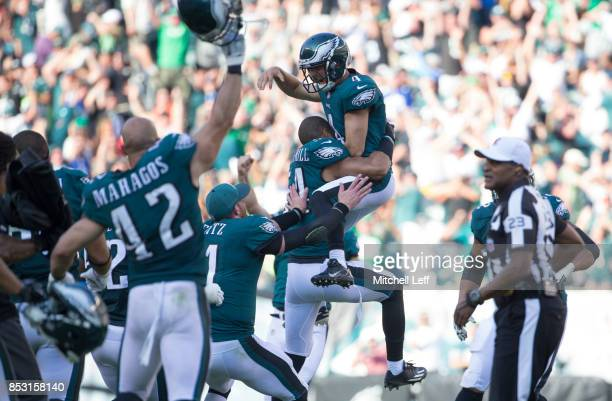 Jake Elliott of the Philadelphia Eagles celebrates with Kamu GrugierHill Carson Wentz and Chris Maragos after kicking the game winning field as time...