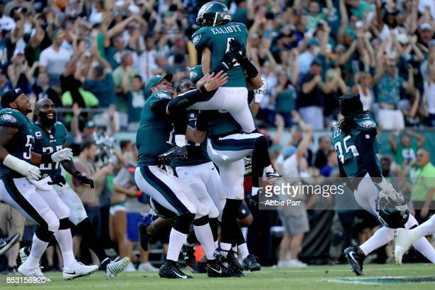Jake Elliott of the Philadelphia Eagles celebrates with teammates after making a game-winning 61 yard field goal against the New York Giants on...