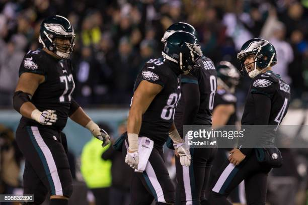 Jake Elliott of the Philadelphia Eagles celebrates with Trey Burton Halapoulivaati Vaitai and Donnie Jones after kicking the game winning field goal...
