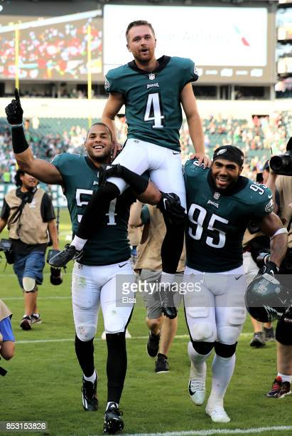 Jake Elliott of the Philadelphia Eagles is carried off the field by teammates Kamu GrugierHill and Mychal Kendricks on September 24 2017 at Lincoln...