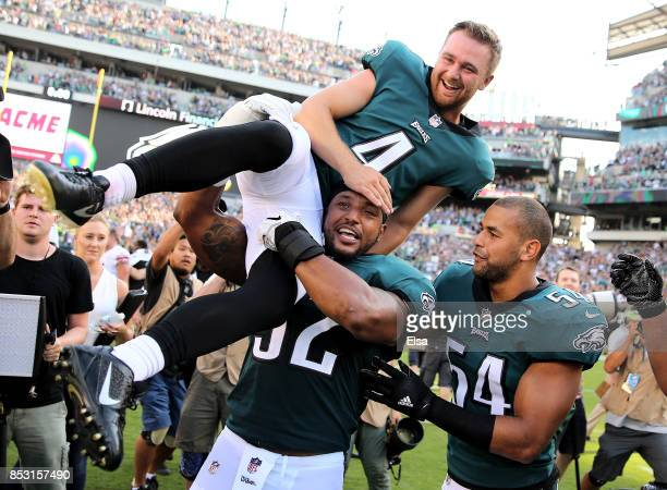 Jake Elliott of the Philadelphia Eagles is picked up by teammates Najee Goode and Kamu Grugier-Hill after Elliott kicked the game winning field goal...