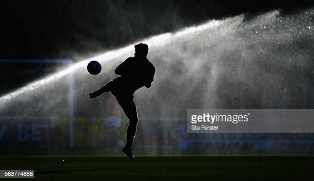 Jake Evans of Swindon Town in action during the warm up ahead of the Pre Season friendly between Swindon Town and Swansea City at County Ground on...
