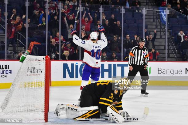 Jake Evans of the Laval Rocket celebrates his game winning goal during the shootout while goaltender Maxime Lagace of the Providence Bruins remains...