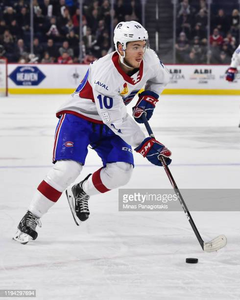 Jake Evans of the Laval Rocket skates the puck against the Cleveland Monsters in overtime at Place Bell on December 10 2019 in Laval Canada The Laval...