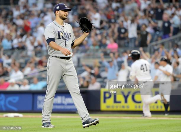 Jake Faria of the Tampa Bay Rays reacts as Miguel Andujar of the New York Yankees rounds first base after he hit a solo home run in the second inning...