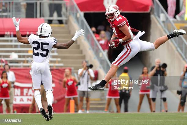 Jake Ferguson of the Wisconsin Badgers catches a pass in front of Daequan Hardy of the Penn State Nittany Lions during the second quarter at Camp...