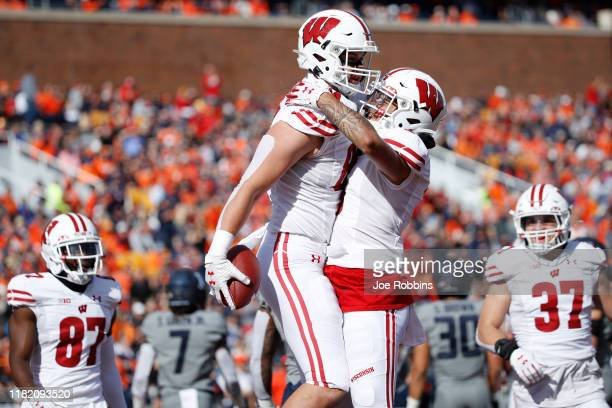Jake Ferguson of the Wisconsin Badgers celebrates after an 18yard touchdown reception against the Illinois Fighting Illini in the first half of the...