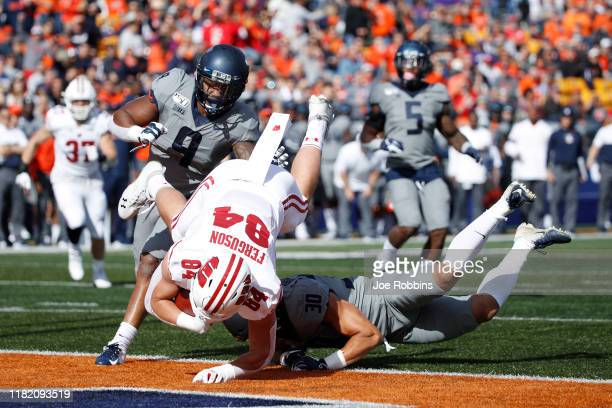 Jake Ferguson of the Wisconsin Badgers flips into the end zone with an 18-yard touchdown reception against the Illinois Fighting Illini in the first...