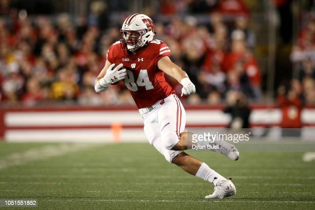 Jake Ferguson of the Wisconsin Badgers runs with the ball in the first quarter against the Nebraska Cornhuskers at Camp Randall Stadium on October 6...