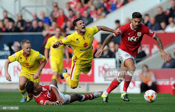 Jake ForsterCaskey of MK Dons is tackled by Mark Little of Bristol City during the Sky Bet Championship match between Bristol City and MK Dons at...