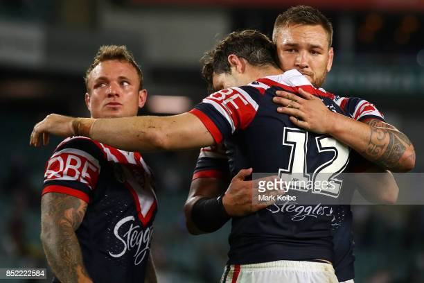 Jake Friend Aidan Guerra and Jared WaereaHargreaves of the Roosters look dejected after defeat during the NRL Preliminary Final match between the...