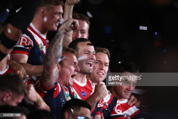 Jake Friend and Boyd Cordner of the Roosters celebrate victory with team mates after the 2018 NRL Grand Final match between the Melbourne Storm and...
