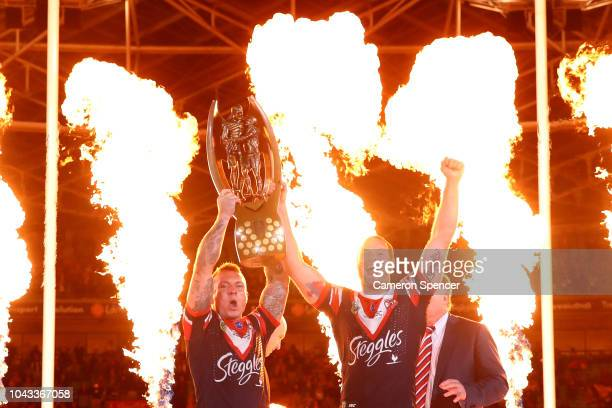 Jake Friend and Boyd Cordner of the Roosters celebrate with team mates after winning the 2018 NRL Grand Final match between the Melbourne Storm and...