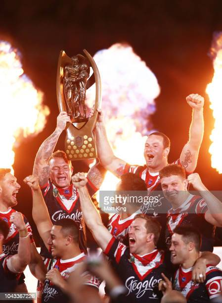 Jake Friend and Boyd Cordner of the Roosters celebrate with the ProvanSummonsÊTrophy during the 2018 NRL Grand Final match between the Melbourne...