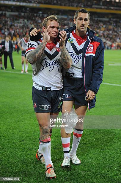 Jake Friend and Mitchell Pearce of the Roosters look dejected after the NRL First Preliminary Final match between the Brisbane Broncos and the Sydney...