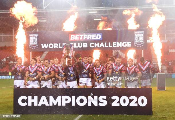 Jake Friend of Sydney Roosters lifts the Trophy after victory in the World Club Series Final between St Helens at Totally Wicked Stadium on February...