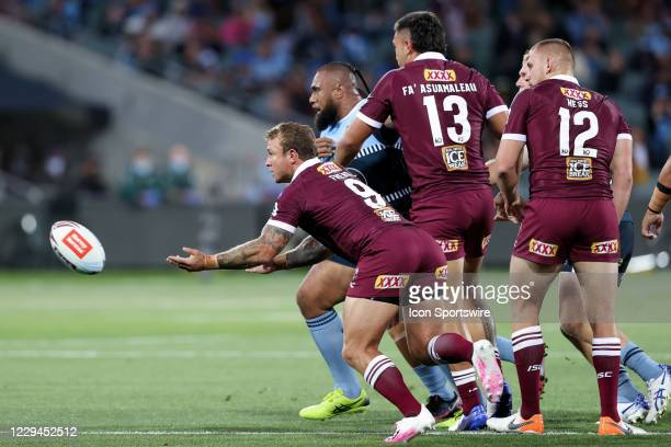 Jake Friend of the QLD Maroons passes during game one of the 2020 State of Origin series between the Queensland Maroons and New South Wales Blues at...