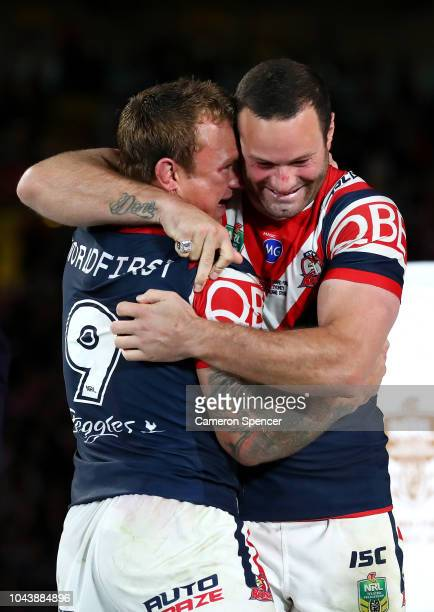 Jake Friend of the Roosters and Boyd Cordner of the Roosters embrace after winning the 2018 NRL Grand Final match between the Melbourne Storm and the...