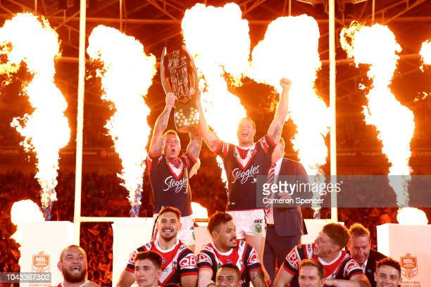 Jake Friend of the Roosters and Boyd Cordner of the Roosters hold aloft the Provan-Summons Trophy after winning the 2018 NRL Grand Final match...