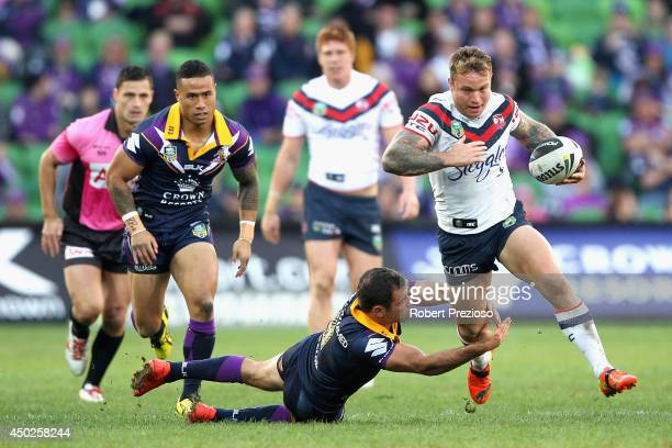 Jake Friend of the Roosters breaks a tackle applied by Cameron Smith of the Storm during the round 13 NRL match between the Melbourne Storm and the...
