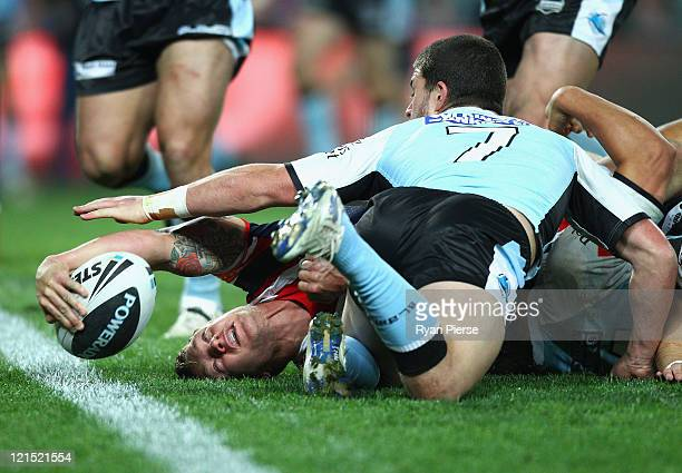 Jake Friend of the Roosters crosses to score a try during the round 24 NRL match between the Sydney Roosters and the Cronulla Sutherland Sharks at...