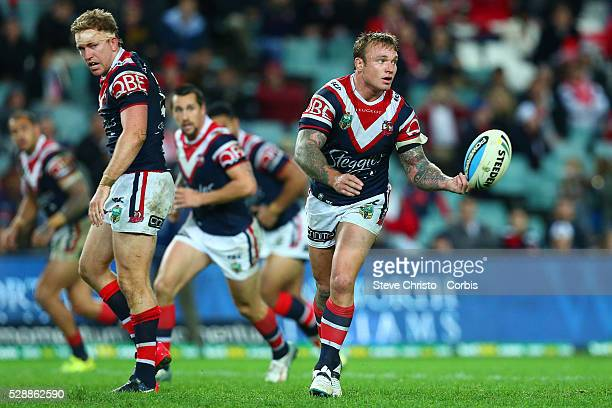 Jake Friend of the Roosters in action from dummy-half against the Dragons during the round 15 NRL match between the Sydney Roosters and the St George...