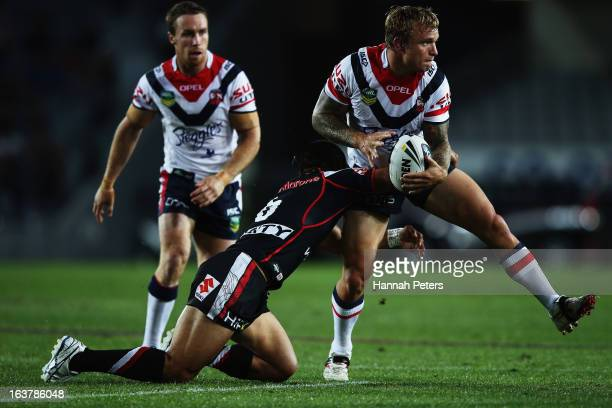 Jake Friend of the Roosters looks to pass the ball out during the round two NRL match between the New Zealand Warriors and the Sydney Roosters at...